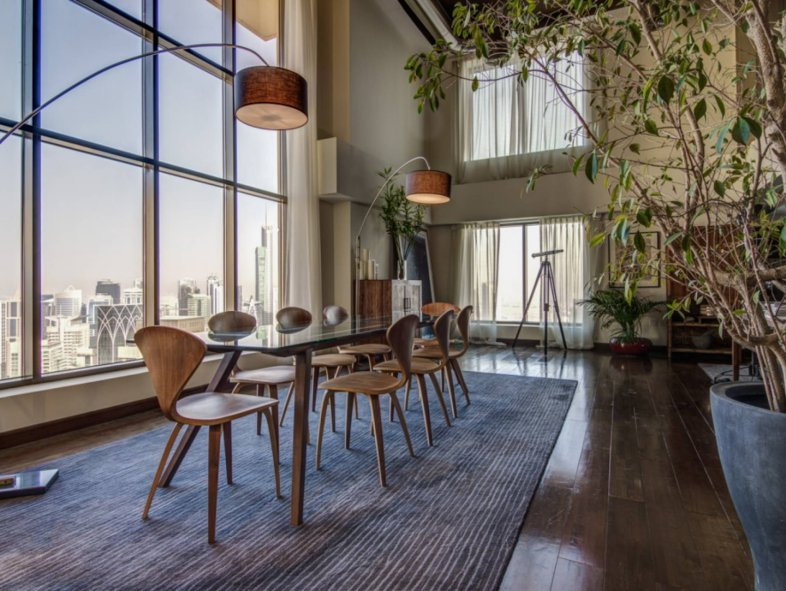 Warm and naturally lit Duplex Loft in Rimal / JBR